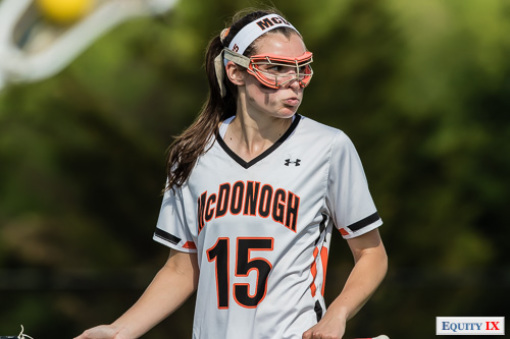 McDonogh #15 with eye-black, orange goggles and a headband looks fierce standing with lacrosse stick and ball at IAAM girls lacrosse finals (2015).  Early Recruit - Early Recruit - © Equity IX - SportsOgram