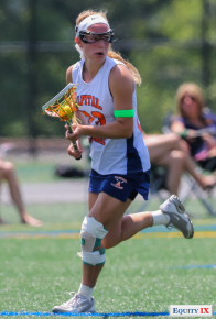 Lexi Ledoyen, #23 Capital Club Lacrosse, carries the ball in the midfield with an injury on her left knee at the Nike Elite G8 girls lacrosse tournament (2015).  The green band on Lexi's left arm shows she has committed to Syracuse as an early recruit.