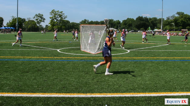Overview of lacrosse field from behind the goal where a Skywalker girls lacrosse player holds the ball and looks to pass to a teammate during a showcase tournament for college coaches - Early Recruiting - Equity IX - SportsOgram - Photo by Leigh Ernst Fri
