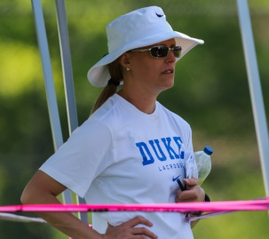 Duke women's lacrosse head coach, Kerstin Kimel, watches prospective student-athletes compete at the Nike Elite G8 girls lacrosse club tournament (2015).  Kimel was instrumental in passing the NCAA early recruiting legislation for lacrosse in 2017.  © Equ