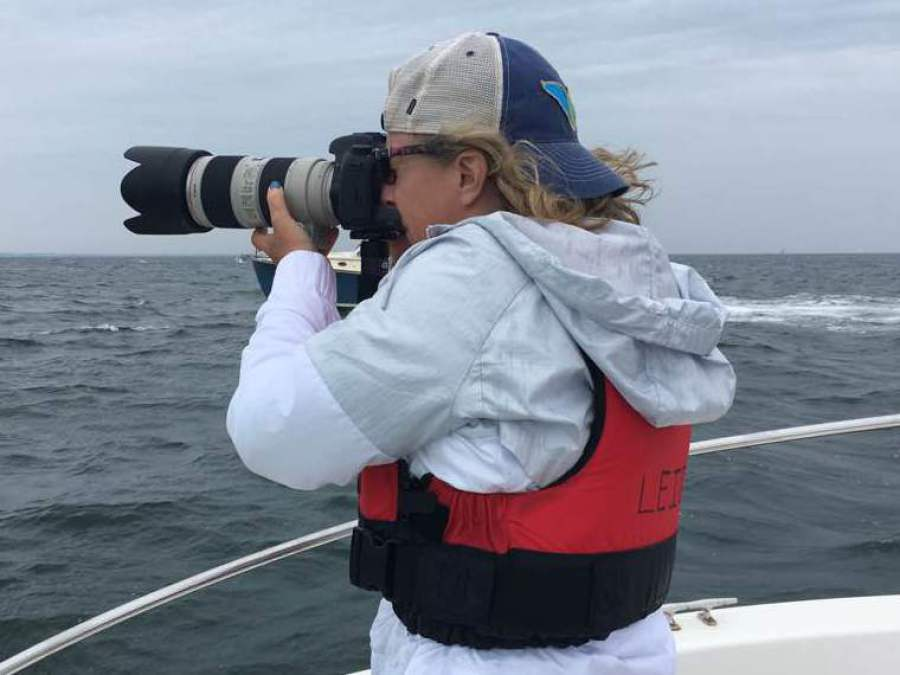 Leigh Ernst Friestedt is the CEO and Founder of Equity IX and SportsOgram which analyze key issues in sports and education: early recruiting, NCAA legislation and Title IX.  Leigh is photographing a sailboat race at the Opera House Cup in Nantucket from a