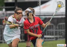 Kylie Ohlmiller - Stony Brook #17 with eye black and goggles drives to goal left handed against Maryland defender - NCAA Women's Lacrosse Quarterfinals © Equity IX - SportsOgram - Leigh Ernst Friestedt