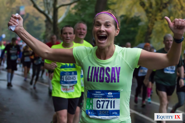 Lindsay Ernst runs in NYC marathon with hands raised to celebrate the 25th mile in Central Park - photo by Leigh Ernst Friestedt © Equity IX - SportsOgram