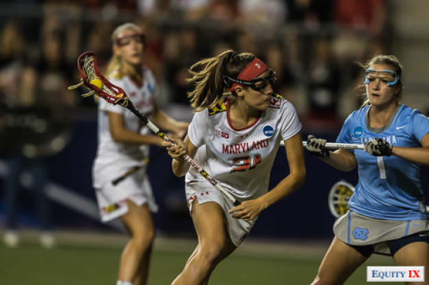 Maryland #21 Taylor Cummings cradles lacrosse ball wearing a red Under Armor headband and goggles in midfield against UNC #1 midfielder 2017 NCAA Women's Lacrosse Championship Game © Equity IX - SportsOgram - Leigh Ernst Friestedt