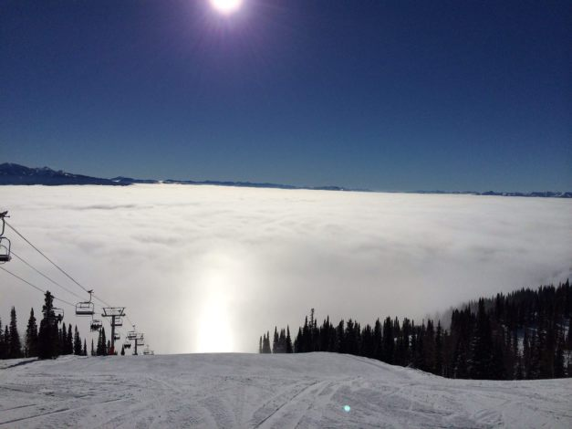 Bright blue clear day on top of the mountain with inversion - clouds are below the top of the mountain at Jackson Hole Wyoming © Equity IX - SportsOgram - Leigh Ernst Friestedt
