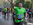 Jim Murphy is drenched in sweat in his bright green t-shirt at the 2017 NYC Marathon at mile 25 - he has a huge smile on his face and waves at the crowd - © Equity IX - SportsOgram - Photo by Leigh Ernst Friestedt
